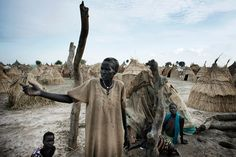 Davorah Nyariera fled fighting in Bentiu  with her children and grandchildren. Having lost everything they own, they live in simple straw hu...