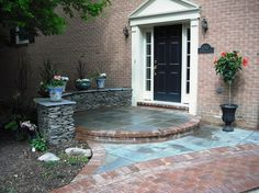 Entry of brick and flagstone