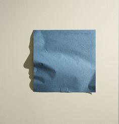 Origiami shadow faces by shadow artist Kumi Yamashita