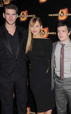 Liam Hemsworth, Jennifer Lawrence, and Josh Hutcherson at the Paris premiere of The Hunger Games today at Cinéma Gaumont Champs-Elysées Marignan.