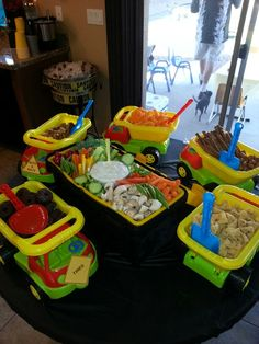 Dump trucks with construction themed foods and a tool box veggie tray (we filed the tool box with ice then placed the tray on top to keep the veggies and dip cold).