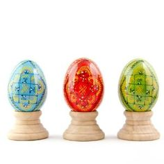 3 Wooden Ukrainian Easter Eggs with Stands #easter This set of 3 wooden Easter eggs is hand-painted with traditional geometric patterns of triangles, rhombuses, waves, crosses, and hashes. Historically, one of the most popular Easter gifts was a hand painted in various patterns Easter egg. Family members, friends gave them to each other and a bowl of Easter eggs would also be set out in the house, to protect against misfortunes. Become part of ancient tradition by sharing these colorful Easter