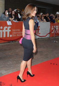 Salma Hayek booty on the red carpet in figure hugging little black dress and suede pumps at Toronto Film Festival