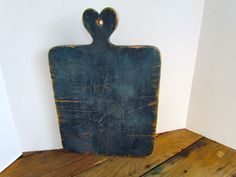 Love this antique blue bread board