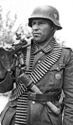 "croatian soldier fighting with the germans under the banner of the croatian division • he carries a m-36 machine gun and plenty of spare ammunition. note the ""potato masher"" grenade stuck under his belt."