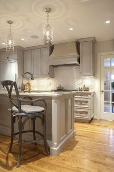 Kitchen with Gray Cabinets/Island and Beautiful Floors. Love that Bar Stool! - Thorsen Construction Image Gallery