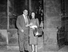 Orson Welles, former husband of Rita Hayworth, smiles happily as he poses with his Italian Countess  Paoula Mori, 24, outside London's Caxton Hall, May 8, 1955. (AP Photo)