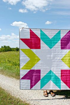 Giant Starburst | A Finished Quilt - maybe I'll just use half square triangles for the rest of my quilting life since combining them makes such gorgeous quilts. Love the giant block and the vibrant colors