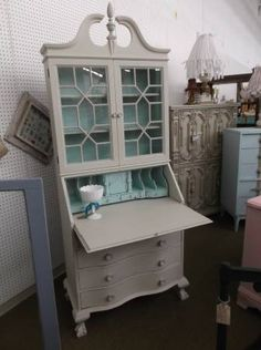SOLD - Shabby chic secretary with 4 drawers in base - Double glass doors on top - Painted creamy white with light blue interior. ***** In Booth D8 at Main Street Antique Mall 7260 E Main St (east of Power RD on MAIN STREET) Mesa Az 85207 **** Open 7 days a week 10:00AM-5:30PM **** Call for more information 480 924 1122 **** We Accept cash, debit, VISA, MasterCard or Discover.