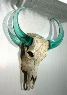 Cow skull with recycled, hand-blown glass horns.