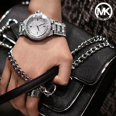 Michael Kors silver women's boyfriend watch for the perfect holiday look.