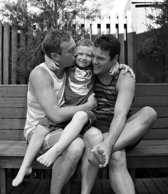 Gay Dads with son.  Cute!
