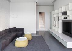 Geometric panels create textured walls inside this monochrome penthouse.