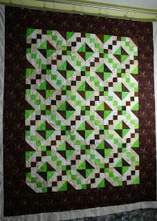 The bright green is so pretty against the really dark brown. color quilt, earthi quilt