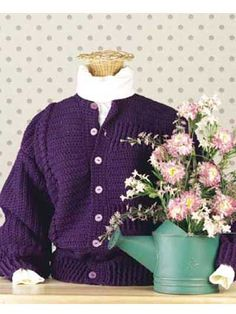 Grape Twin-Textured Cardigan - Each side of the front of this charming cardigan has a different look: One side features a cable, the other a ridge pattern. Size: 8-10 (12-14, 16-18). Free #crochet pattern!