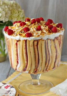 Raspberry Lemon Meringue Trifle - a gorgeous vertical trifle with pound cake, lemon curd, raspberry jam, and meringue. | From SugarHero.com
