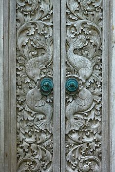 grey doors with fish carvings