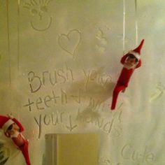 Spray snow on bathroom mirror elf on the shelf Christmas ideas