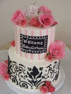 """Pink and black baby shower - Two-tiered cake (red velvet 8"""" and vanilla with strawberries 6"""") finished in Italian meringue buttercream with fondant cutout stripes and black mosaics"""