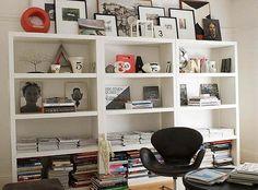 I love the frames on top of the bookshelves!