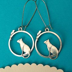 $7.00.  CAT AND MOUSE earrings.  Adorable!  :)