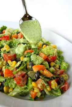 Southwestern Chopped Salad with Cilantro Dressing 1 cup loosely packed cilantro, stems removed and roughly chopped 1/2 cup plain Greek yogurt 2 Tbsp. fresh lime juice (about 1/2 lime) 1-2 garlic cloves 1/4 cup olive oil 1 1/2 tsp. white vinegar 1/8 tsp. salt (more to taste) Directions Puree all ingredients in a blender or food processor until smooth.