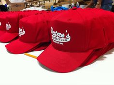 Big stack of red hats ready to ship!  www.visualimp.com