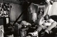 """1991: Dennis """"Wildman"""" Walker is surrounded by the donated items given to him during his 61-day stay in a shelter under a billboard. Walker had lost a bet on a Bengals game and remained there until they won a game. See more of the top 40 radio personalities in the last 40 years in our gallery."""