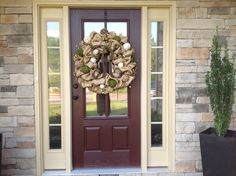 Custom burlap and moss wreath with a brown initial on a customer's door!  Looks great!!!