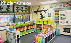 Rainbow theme classroom library with ikea expedit shelf bench to define the space