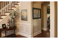 White molding framed by a chair rail and tall base board add simple, but powerful appeal. The Weddington Trace Preserve community. From Standard Pacific Homes, near Charlotte.