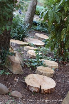 Foot path made from an old tree, with lots of other ideas for a backyard kid-made fairyland from Simply Natural Mom. backyard ideas, kids tree forts, backyard kids fort, foot path, landscaping backyard for kids, kids garden path, backyards kids, natural backyard, garden fort