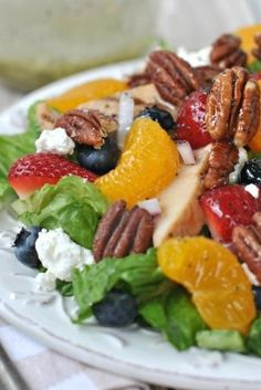 Strawberry Pecan Salad with a sweet, homemade Lemon Poppyseed dressing and candied Pecans