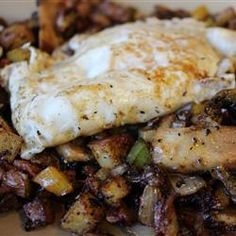 """Jay's Hearty Breakfast Skillet   """"Potatoes, peppers, onion and mushrooms are all fried up with bacon, and smothered with cheese. Top with sunnyside-up eggs (or your favorite style) and serve with toast or muffins on the side."""""""