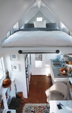 Happy Camper - wave avenue - The Loft - Planning on a camping trip but don't want to bring your tent? Why not bring a whole 'camping house'? Inside this trailer is all you need and a queen sized bed! I love that it has bookshelves, the whimsical prints on the rug and most specially, the loft!