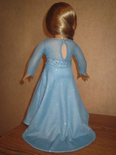 """This GORGEOUS Elsa/Frozen inspired gown for 18"""" / American Girl dolls was made using the bodice and sleeves from Lee & Pearl Pattern 1055: Skating Dresses for 18"""" Dolls (https://www.etsy.com/listing/179931138/lp-pattern-1055-skating-dresses-for-18?ref=shop_home_active_7) Dress by JanieCarrollDesigns, $32.00 on Etsy."""
