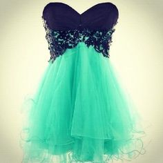 Mint green and navy blue short, sweetheart cut, strapless, flowy dress.