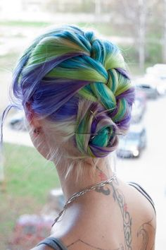 Purple, green and blue hair in a gorgeous braided updo.