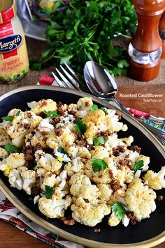 The BEST Roasted Cauliflower recipe with Italian dressing, feta cheese and browned butter crouton crumbs.