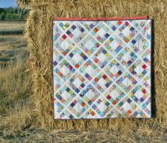 Charmed Quilt (free pattern & tutorial) - uses 2 packs of charm squares | Live Love Sew