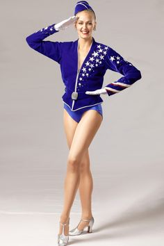 """The """"Velvet March"""" is a patriotic look designed by Deborah Newhall and was introduced by the Rockettes in 1999. This look has been worn at various milestone events.  #rockettes #NYC #costumes #dancers #glamorous #white #blue #sailor #patriotic #stars #stripes #velvet"""
