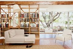 "lots to love here -glass walls, rustic wood ceiling, bookcase room divider.  ""Rustic modern"""