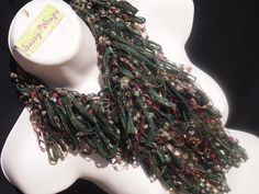 "New Christmas Holiday Scarves. Ribbon Yarn Loopy Scarf shown is ""Evergreen"" .... $40 www.sassy-wraps.com"