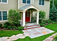 Flagstone path leads to stone landing & symmetrical landscaping around gabled Front Porch, Liquidscapes, Pittstown, NJ