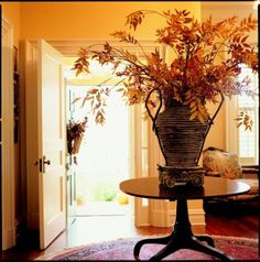 beautiful entry - round rug & beautiful fall arrangement on round table