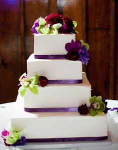 yellow flowers, shades of purple, tiered cakes, white cakes, purple cakes, purple and green wedding cake, green weddings, green flowers, purple wedding cakes