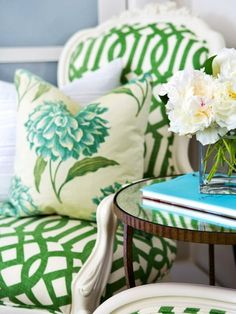 love this flower cushion on arabesque inspired green and white upholstered chair, with round side table. Fingers crossed for my own!