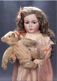 german doll w steiff teddy bear