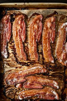 Cook bacon in the oven. Cover cookie sheet with tin foil first. Bake at 375 for about 20 min instead of 400 for ten because the lower and slower the more fat renders out. Then all the bacon is done at the same time, meanwhile you are free to make the rest of breakfast.