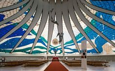 Interior - Cathedral of Brasilia - Architect Oscar Niemeyer   Foundation stone laid in 1958, completed building dedicated in 1970.   Inside, the light-filled cathedral is overseen by three angels, suspended from the ceiling by steel cables.  Picture: Arcaid Images / Alamy